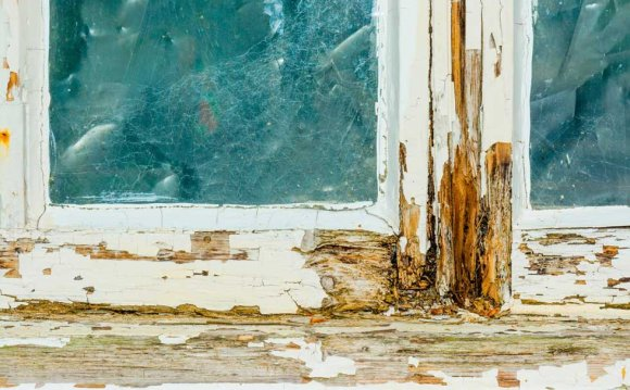 A decaying timber window frame